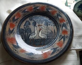 Antique Tonala pottery plate, cranes.