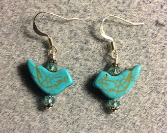 Turquoise howlite gemstone bird bead earrings adorned with turquoise Chinese crystal beads.