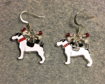 Black and white enamel dog charm earrings adorned with tiny dangling black, white, and red Chinese crystal beads.