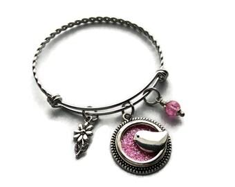 Bird with pink bangle bracelet