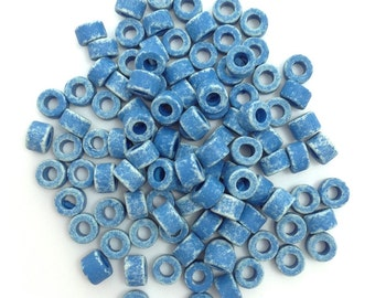 Ceramic cylinder, blue spotted, 6 mm, 100 pieces
