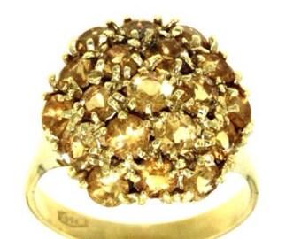 Elegant ring studded with stones of Qusrzo Citrine