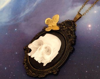 Necklace skull bleached human and his butterfly