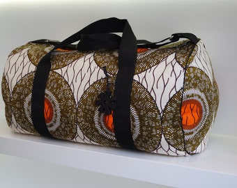 Weekender bag of colorful african wax fabric full of Adinkra symbolism from Ghana by the symbol wisdom to give as a birthday present