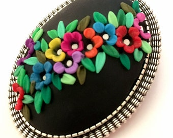 Brooch in polymer clay.