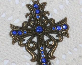 Swirled Curly-Cue Starburst Aura Deep Navy Blue Rhinestones Pectoral Cross Brasstone Pendant Necklace