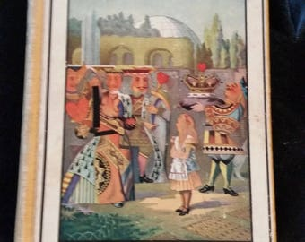 vintage ,Alice's adventures in wonderland and through the looking glass,colored illustrations ,by ,Lewis Carroll