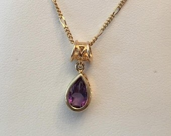 "Vintage 14k yellow gold Bezel Set Pear Shaped Amethyst Pendant in Filigree Mounting and Fancy Filigree Bail on a 16"" Thin Figaro Chain"