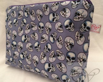Grey Skull/Skulls Make Up Bag. Medium size with a purple zip and purple waterproof lining