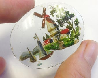 Antique, reverse painted on glass, miniature scene of a windmill and sailing boats.