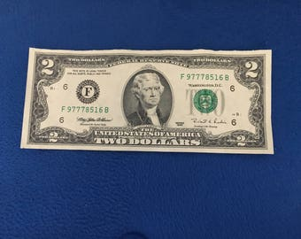 777 lucky numbers in two dollar serial number bill