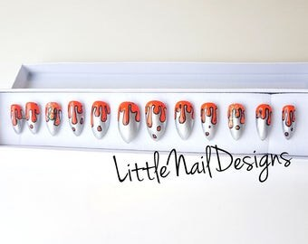 Hand painted dripping orange and silver false nails
