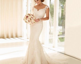 Gorgeous Lace Mermaid Style Wedding Dress with Cap Sleeves, a Chapel Train, and a Partially Sheer Back with Button Detail