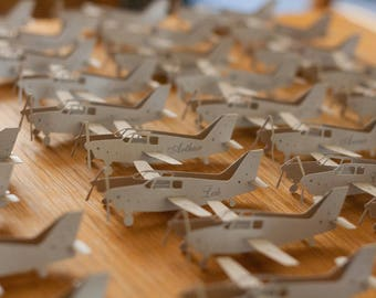 Airplane paper cut place card
