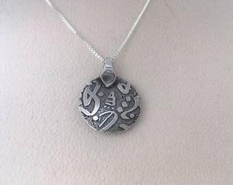 Sterling silver reversible lentil bead pendant.