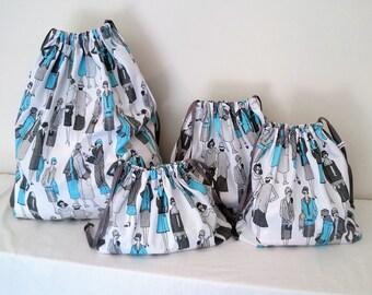 Lady in Blue Print Set of 4 Cotton Travel Bags, Laundry Bag, Lingerie Bag, Utility Bag, Shoe Bag or Sock Bag.