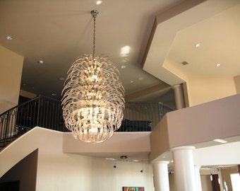 Custom rolled glass chandelier by Prestige Chandelier