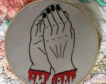 Embroidered bleeding hands