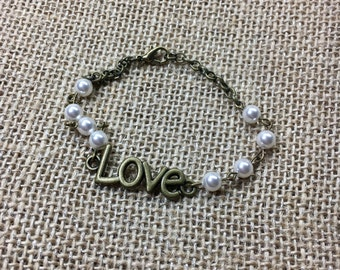 Antique brass pearl and Love connector bracelet