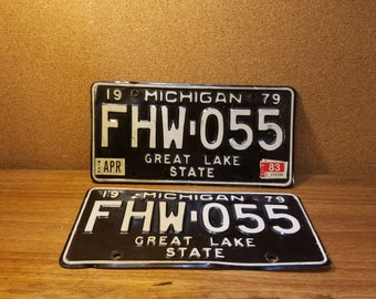 Vintage Michigan Pair of License Plates 1979 1983 Black and White