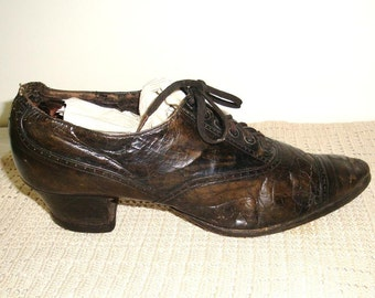 Antique women's lace up leather shoe. Dark brown pump heel. Nailed sole. This is for decor only unless you have the other one.