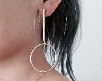 Long bar with large circle earrings