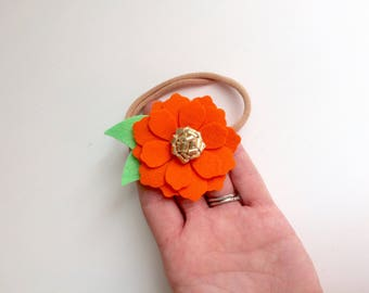 Bright orange zinnia flower with gold center - alligator clip - headband