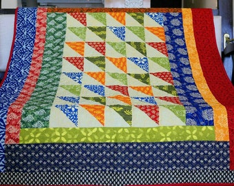 Boho home decor. Patchwork quilt. Homemade quilt. Handmade quilt. Lap quilt. Throw quilt. Colourful throw. Blue and red quilt. Quilt sale