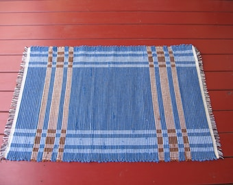 Handwoven cotton rug in log cabin weave
