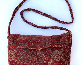 Cute cross body purse in red tapestry fabric.