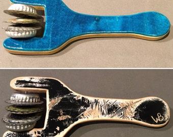 Recycled skateboard music shaker