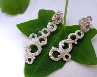 "Silver asymmetry earring ""Schiuma lunga"""