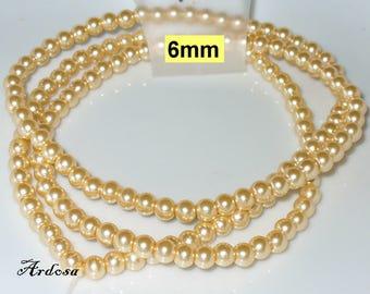 1 strand 82cm = 152 glass pearls peach 6 mm (806.34.1)