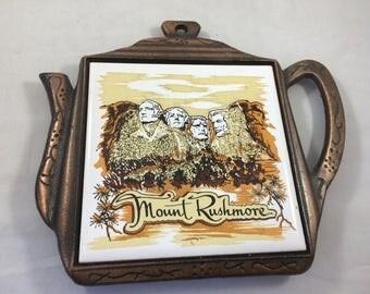 Vintage Mount Rushmore Tile/Trivet in Metal Teapot Shaped Holder