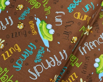 Brown Frogs with Words from the Frogland Friends Collection by Nidhi Wadhwa for Henry Glass Fabrics