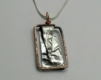 Mixed metal reticulated aluminum rectangular hammered copper frame pendant
