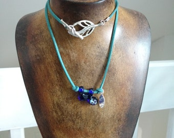 Hanging Sloth Necklace - Cobalt Blue Lamp Work Glass, Sterling Silver Leaf Charm, and Leather