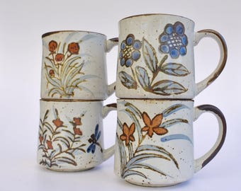 stoneware mugs; hand painted flower designs