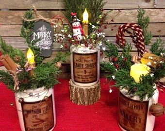Primitive Christmas ceramic floral arrangement with battery operated LED candle.
