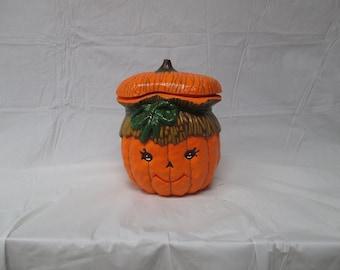 a pumpkin candy dish