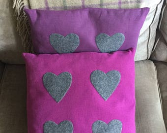 Cotton canvas cushions, in lilac and pink, with grey felted wool aplique hearts