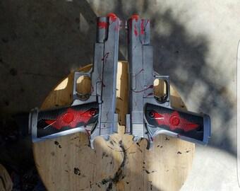Pair of custom Redhood pistols.