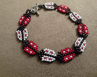Red and White Lady Bug
