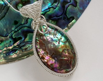 Pretty Abalone wire wrapped silver pendant with sterling silver chain, pinks, blues and greens