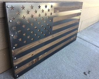 American flag mounted on dark stained wood