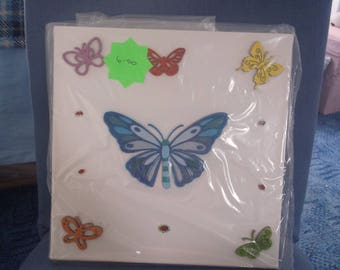 blue butterfly with wooden stencils