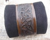 Mens Leather Cuff Bracelet with Hand Tooled Celtic Trinity Knot design custom made to order. Free shipping.