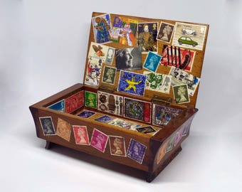 A small wooden box decoupage with postage stamps