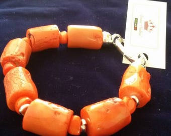 Orange Bamboo coral-rigid bracelet with sterling silver clasp.