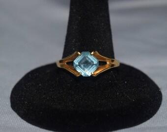 Gold Ring with Aquamarine Gemstone